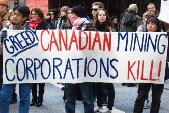 Banner Denouncing Greed Canadian Mining Corporations