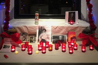 Red candles burn on the altar created by author Alexandra Holmstrom-Smith for this year's celebration of Martyrs' Day.