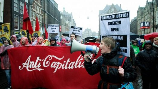 An estimated 40,000 people rallied March 10 at the Climate March in Amsterdam, pushing the Dutch government to move faster on climate action. Twenty-six percent of the Netherlands sits below sea level. (Photo by Paulo Amorim/Nurphoto via Getty Images)