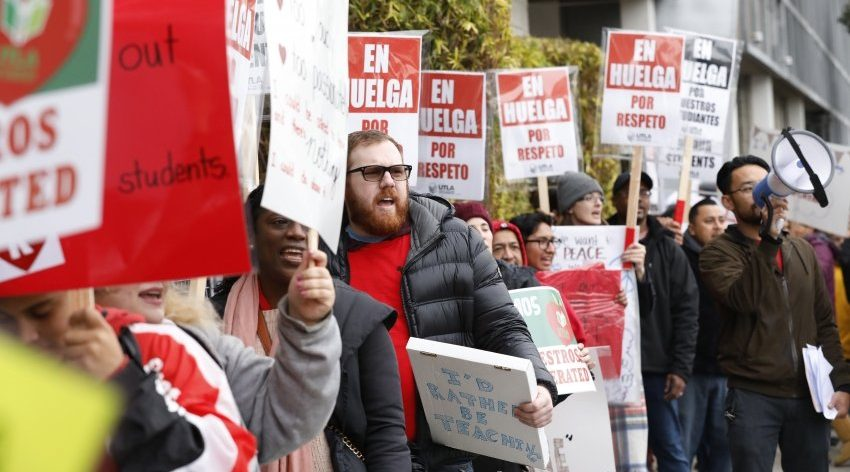 Teachers at The Accelerated Schools, a community of public charter schools in South Los Angeles picket outside the school on second day of the Los Angeles school teachers strike on January 15, 2019 in Los Angeles, California.