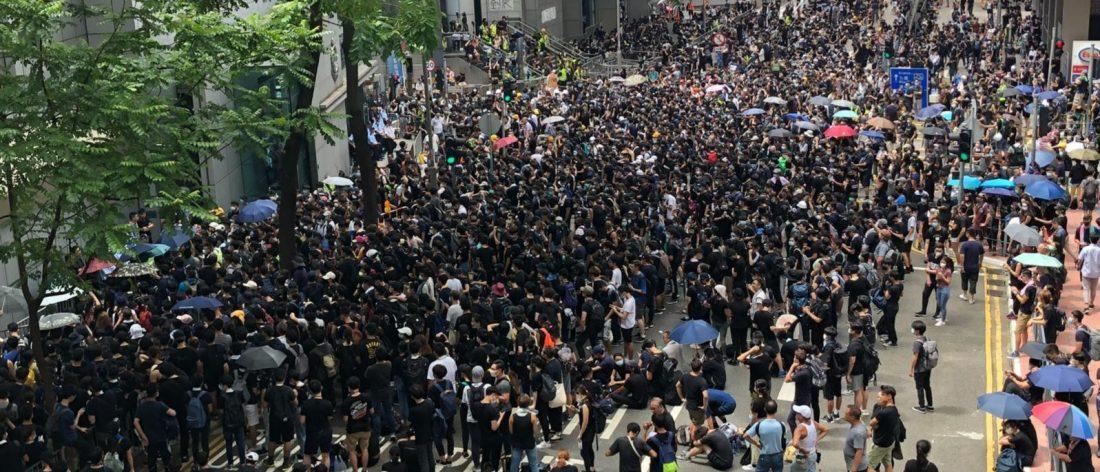 Protest Outside a Hong Kong Police HQ   Iris Tong - VOA.