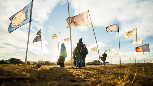 Flags fly at the Oceti Sakowin Camp in 2016, near Cannonball, North Dakota