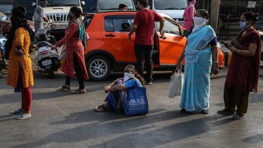 Women in India queue up to buy groceries