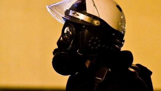Police officer wearing gas mask  Credit: Tony Webster/Creative Commons