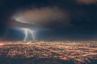Lighting striking in storm at dawn